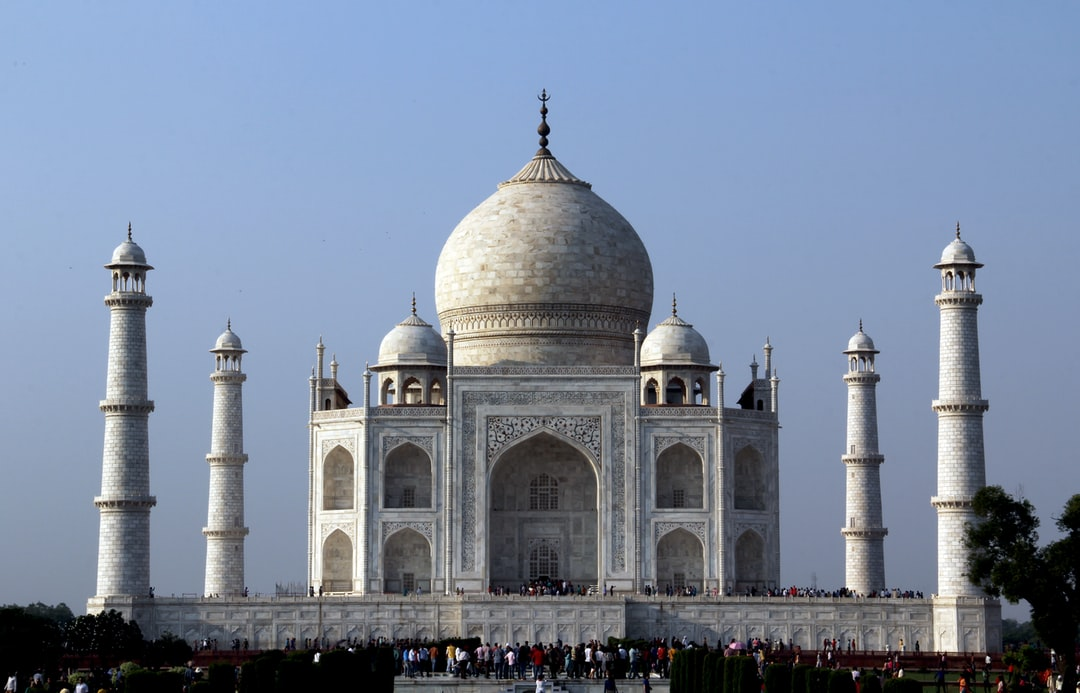 A large building with Taj Mahal in the background